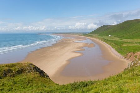 cymru: Welsh beach Rossili The Gower South Wales UK in summer with blue sky Stock Photo