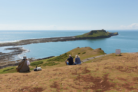 cymru: Beautiful summer sunshine and warm weather drew visitors to Worms Head at Rhossili, The Gower, Wales on Thursday 2nd July 2015 Stock Photo