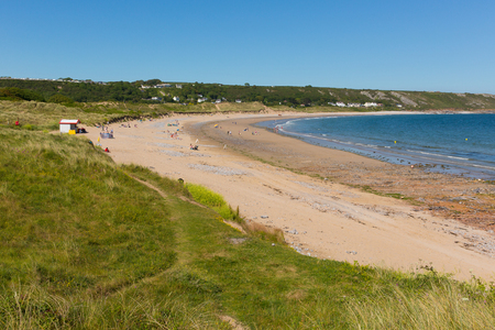 bristol channel: Port Eynon The Gower Peninsula Wales uk popular tourist destination and near Oxwich and Three Cliffs Bay on a summer day with clear blue sky Stock Photo