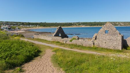 cymru: Ruins of the old salt house Port Eynon Bay The Gower Wales uk popular tourist destination and near Oxwich and Three Cliffs Bay on a summer day with clear blue sky