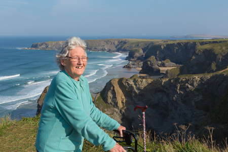 lady: Active old lady pensioner by beautiful coastal view in summer Stock Photo