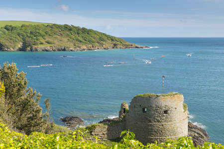 estuary: Devon coast Salcombe England uk Charles fort ruins with pilot gig boats and blue sea and sky Stock Photo