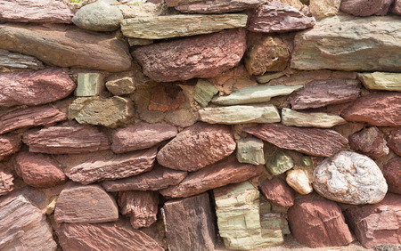 dry stone: Dry stone wall with red and pink rocks