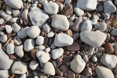 shingle: Grey pebbles and stones and shingle, a background texture St Audries Bay Somerset uk