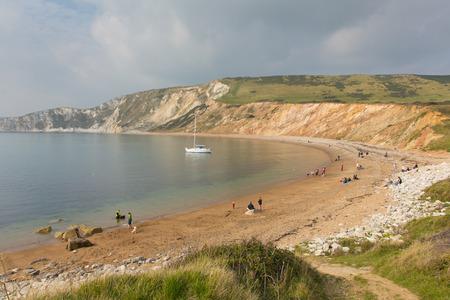 headland: People on the beach Worbarrow Bay east of Lulworth Cove on the Dorset coast England uk