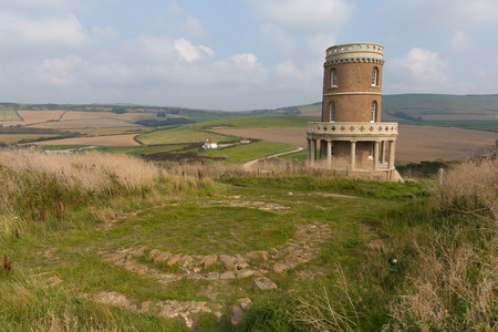 inlet bay: Clavell Tower overlooking Kimmeridge Bay east of Lulworth Cove on the Dorset coast England uk