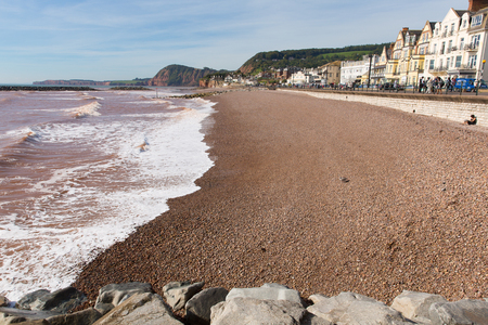 waves  pebble: Sidmouth Devon England UK with pebble beach and waves and hotels Jurassic coast Stock Photo