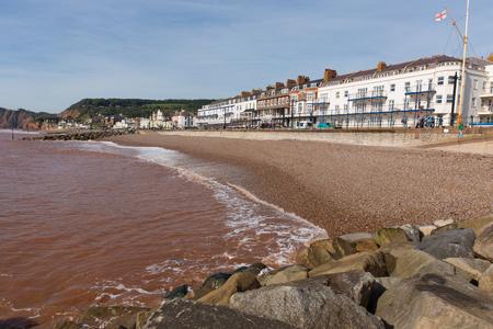 shingle beach: Devon coast town of Sidmouth England UK with shingle beach waves and hotels Stock Photo