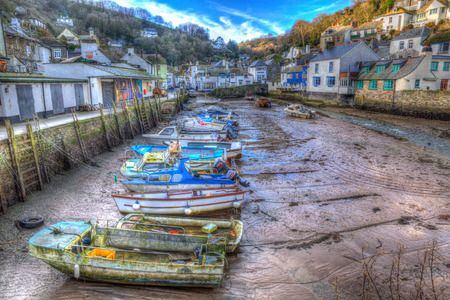 south west england: English harbour Polperro Cornwall South West England UK out of season in winter with boats at low tide in HDR