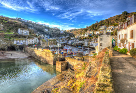 south west england: Polperro Cornwall England with houses and harbour wall in HDR like painting English south west coast fishing village Stock Photo