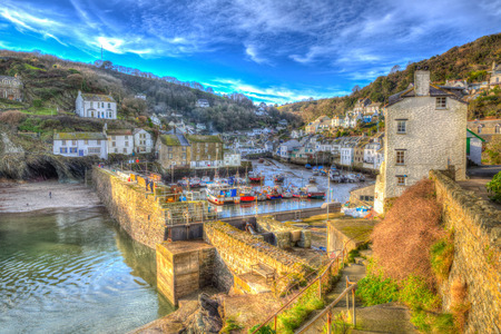 south west england: English south west coast fishing village Polperro Cornwall England with houses and harbour wall in HDR like painting