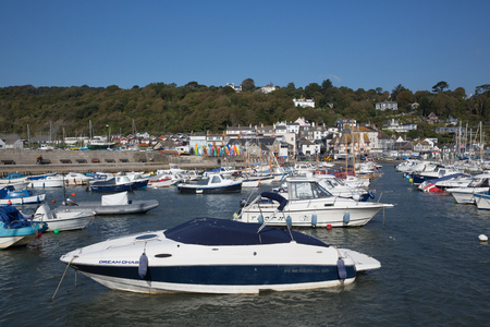 lyme: Boats in the harbour on a beautiful calm still day Lyme Regis harbor Dorset England UK with on the English Jurassic Coast Stock Photo