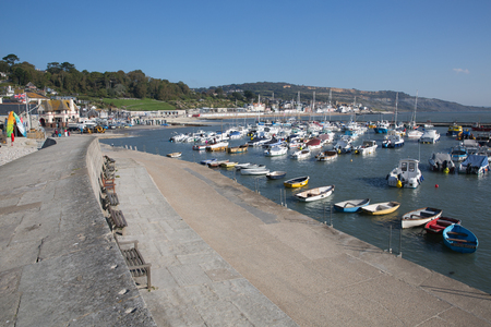 lyme: Lyme Regis harbour Dorset England UK with boats on a beautiful calm still day on the English Jurassic Coast Stock Photo