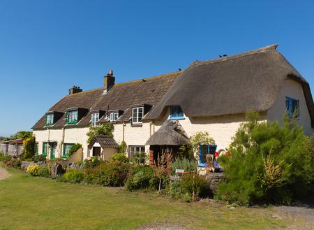 weir: Coast cottages Porlock Weir coastal village Somerset England UK near Exmoor Heritage Editorial