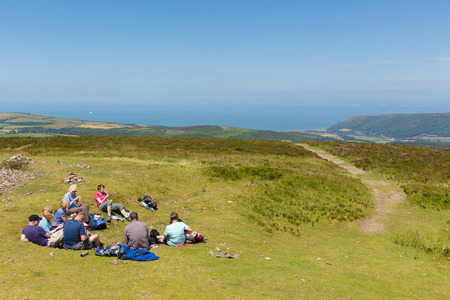 climbed: Walkers enjoying a rest in the beautiful summer weather having climbed to the top of Dunkery Hill, Somerset on Friday 10th July 2015 Stock Photo