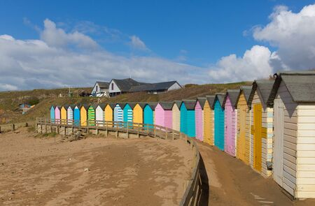 beach huts: Colourful pastel beach huts on the beach Bude North Cornwall England uk on a beautiful day Stock Photo