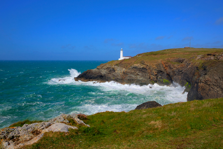 south west coast path: English lighthouse at Trevose Head North Cornwall coastline between Newquay and Padstow uk on south west coast path in rich colours Stock Photo