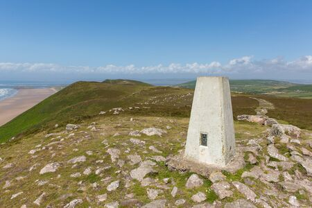 cymru: Trig point top of Rhossili Down The Gower Wales UK in summer Stock Photo