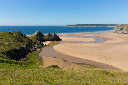 bristol channel: Welsh coast Three Cliffs Bay the Gower Wales uk in summer sunshine beautiful part of the peninsula Stock Photo
