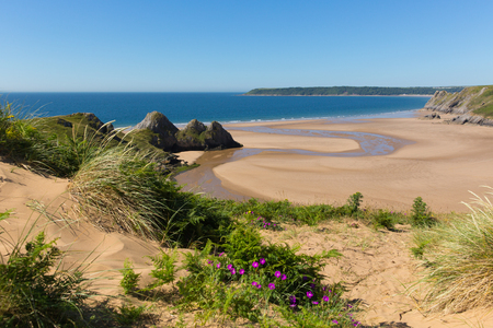 bristol channel: The Gower Wales uk Three Cliffs Bay in summer sunshine beautiful part of the peninsula