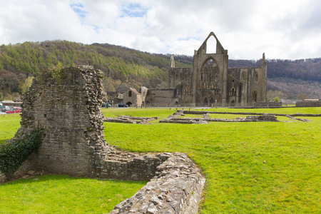 abbey ruins abbey: Tintern Abbey Chepstow Wales UK ruins of Cistercian monastery popular tourist destination