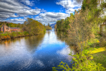 ness river: Fort Augustus Scotland UK River Oich popular tourist village next to Loch Ness in colourful HDR Stock Photo