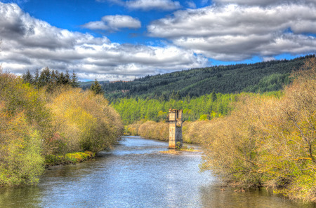 ness river: River Oich Fort Augustus Scotland UK Scottish Highlands popular tourist village next to Loch Ness with bridge tower in colourful HDR