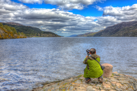 Loch Ness Scotland UK Photographer seeks the classic shot of Nessie the monster in colourful HDR Stock Photo