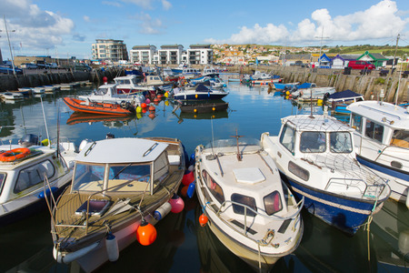 West Bay Dorset uk harbour with boats on a beautiful day with blue sky in summer Editorial