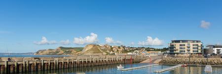 West Bay harbour Dorset uk panoramic view to Golden Cap Editorial