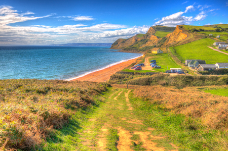 South west coast path Eype Dorset Jurassic coast in bright colourful HDR south of Bridport and near West Bay England UK