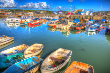 Dorset coast harbour at West Bay uk on a beautiful day with blue sky in summer colourful HDR