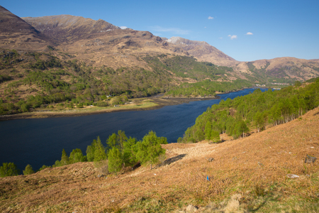 Beautiful Scottish Loch Leven Scotland UK in summer with mountains sunshine and blue sky