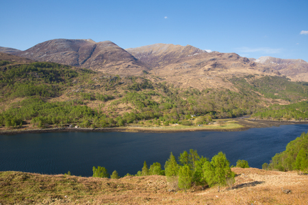Scotland in spring beautiful Scottish Loch Leven UK with mountains sunshine and blue sky Stock Photo