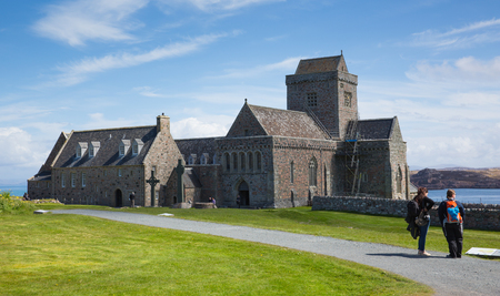 People visiting Iona Abbey Scotland UK by Mull