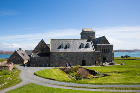 IONA, SCOTLAND, UK-MAY 6th 2016:  Beautiful sunny spring weather was enjoyed by visitors to historic Iona Abbey, Isle of Iona, Scotland on Friday 6th May 2016
