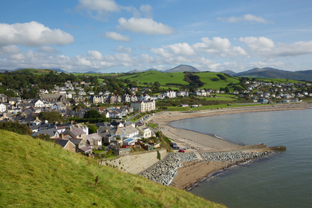 Criccieth beach North Wales UK located south of Caernarfon in summer with blue sky on a beautiful day