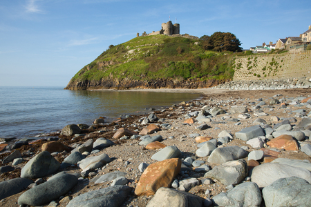 Criccieth beach North Wales UK historic town located south of Caernarfon in summer with blue sky on a beautiful day Stock Photo