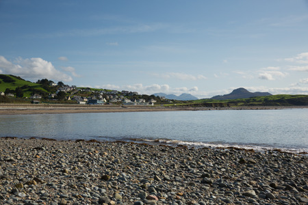 Criccieth beach and bay North Wales UK located south of Caernarfon in summer with blue sky on a beautiful day