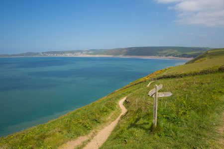 South west coast path to Woolacombe Devon from Croyde direction in summer with blue sky Stock Photo
