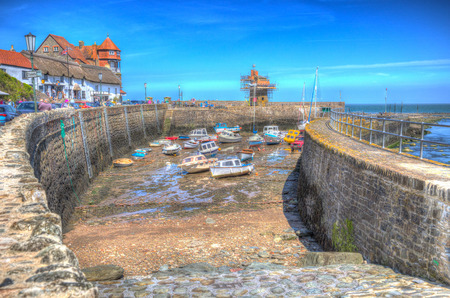 lyn: Lynmouth harbour Devon England UK with boats in colourful hdr