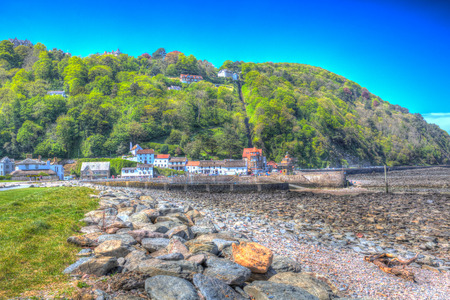 lynmouth: Lynmouth harbour Devon England UK with hillside railway in colourful hdr