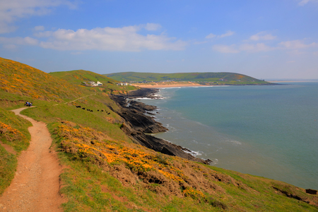 South west coast path to Croyde from Woolacombe Devon England UK in summer with blue sky