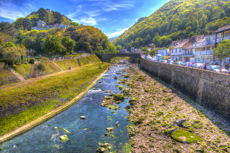 Lynmouth Devon England UK river running through tourist town in colourful hdr Stock Photo