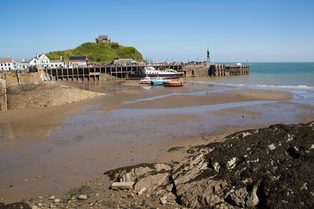 ILFRACOMBE, DEVON, ENGLAND, UK-MAY 8TH 2017: Beautiful spring sunshine and clear blue skies were enjoyed by visitors to Ilfracombe harbour, Devon, on Monday 8th May 2017 Editorial