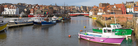WHITBY, NORTH YORKSHIRE, ENGLAND, UK-FEBRUARY 21ST 2017: Fine calm winter weather was enjoyed by sailors and visitors to the harbour Whitby, North Yorkshire, on Tuesday 21st February 2017, panoramic view Editorial
