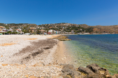 Clear blue sea Xabia Spain at Platja de la Grava beach located south-east of Denia also known as Javea Banco de Imagens