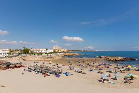 Beautiful autumn sunshine and hot weather drew holidaymakers and visitors to the Playa Cala Capitan sandy beach near La Zenia, Spain on Friday 5th October 2018 報道画像