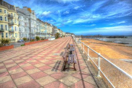 Hastings promenade and seafront with hotels and buildings East Sussex England in colourful HDR