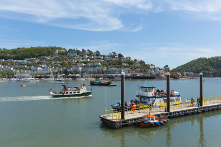 Dartmouth Devon UK with people waiting for boat trips in beautiful spring weather